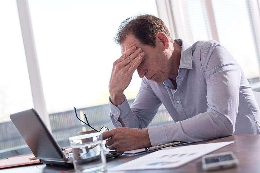 man stressed while working from home