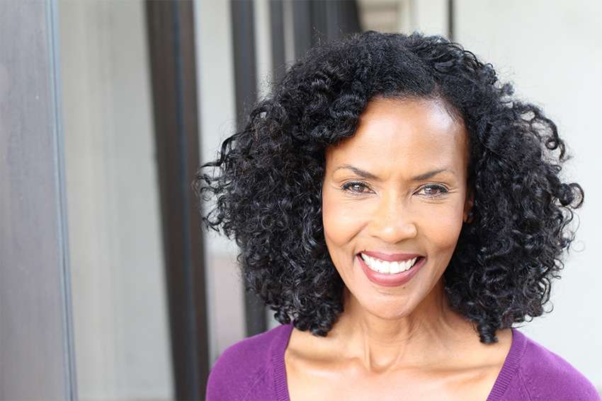 mature woman showing off her amazing smile